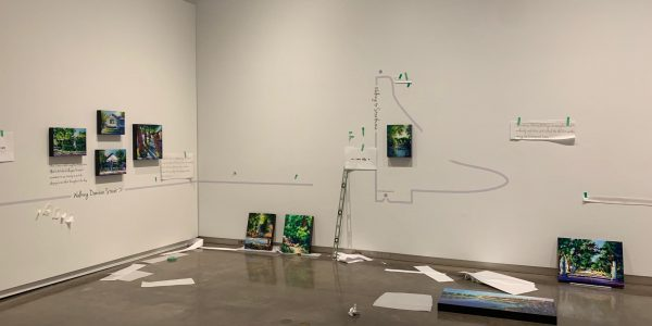Installing paintings in the Esplanade Gallery of Theresa Eisenbarth new exhibit